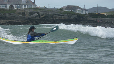 Justine surfing in Trearddur Bay, Anglesey, 2012